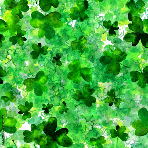 Leinwandbild Motiv A seamless pattern with watercolor drawings of shamrocks, Irish clovers, a vibrant green St Patrick's Day repeat print