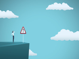 Business risk vector concept. Businessman standing on the edge of cliff with warning sign. Symbol of danger, failure, bankruptcy, recession and crisis.