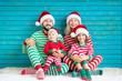 Leinwanddruck Bild - Happy family having fun at Christmas time