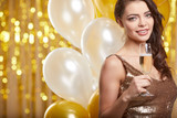 Woman in evening dress with champagne glasses - new year, celebration - 229156310