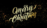 Christmas golden light sparkles and gold calligraphy lettering. Xmas holiday golden glitter light blurs, Merry Christmas vector greeting card - 229169975