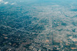 View from airplane window on fields in wing with top view of Singapore - 229170103