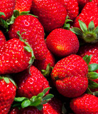 Fresh ripe strawberries close-up. Background from them - 229178154