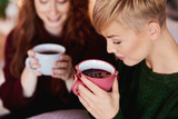 Girl drinking hot tea or mulled wine - 229179375