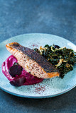 Sumac spiced salmon with beetroot puree and fried kale - 229181525