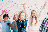 Happy multicultural group of kids having fun during birthday party with confetti - 229182389