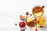 Autumn hot tea with lemon and spices - 229189782
