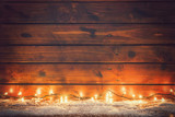 Christmas lights on the old wooden background