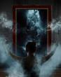 Mirror. Terrible ghost on dark smoke