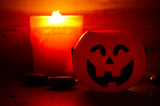 Three pumpkins smile and candle decorate for halloween night - 229226989