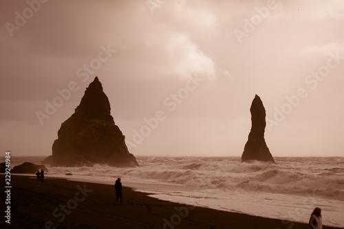 Leinwandbild Motiv Rocks Reynisdrangar near Vik on a sunny day - Iceland