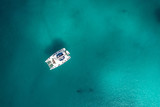 Spectacular aerial view of  yacht floating on a clear and turquoise sea, Seychelles in the Indian Ocean.Top view from drone