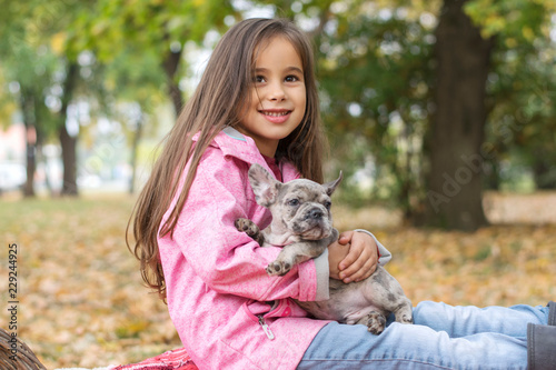 Portrait of a little girl with her dog