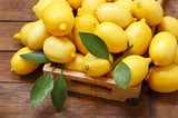 fresh lemons in a wooden box, top view - 229250543