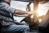 Truck Driver Behind the Wheel - 229255564