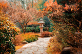 View at monument in japanese garden and alley. Autumn season time scene - 229259319