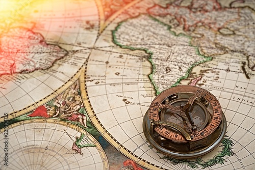 Old map, compass , navigation and geography . © Studio13lights