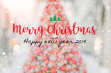 Fototapety Christmas and Happy new year 2019 on blurred bokeh christmas tree banner background with snowfall.