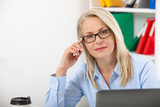 Portrait of a attractive business woman with glasses at office - 229355383