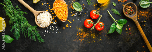 Ingredients for cooking placed on black background. - 229357393