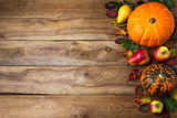 Fall rustic background with pumpkin, pear, copy space - 229358954