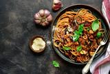 Spaghetti alla norma - traditional italian pasta with eggplants and tomato. Top view. - 229364325