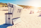 Beach - chairs on the island Sylt on late afternoon. - 229369791