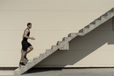 Concept of success and achieving your goal, man climbing stairs.