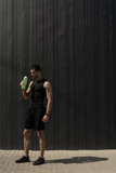 Portrait muscular man taking a break to hydrate his body after