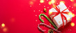 Christmas gift box and candy cane with shining lights. Long banner format