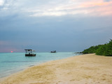 Maldives background. Sunset over the tropical sea and coral beach with colorful cloudy sky. Boats on the horizon. North Male Atoll Asdu, Indian Ocean. - 229405529