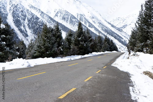 highway through mountain with snow at winter