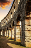 The Roman Amphitheater in Pula at sunset, ancient monument in Croatia. - 229507341