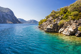 Rocky coast of the island in the Aegean sea - 229508172