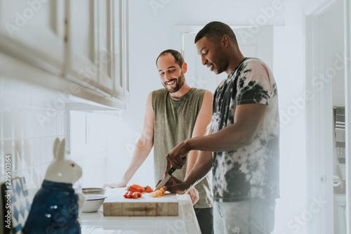 Leinwandbild Motiv Couple cooking in kitchen