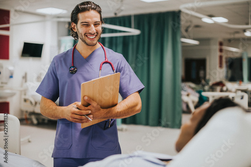 Leinwanddruck Bild Handsome young physician at a hospital
