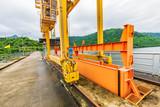 The machine  for drainage from the dam to prevent flooding. Khun Dan Prakarnchon  Dam, Thailand. - 229514130
