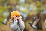 beautiful girl in knitted crown walks in autumn park - 229520531