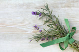 fragrant romantic flower/ bouquet of English lavender decorated with green bow top view on a wooden table