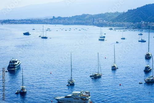 Sailboats near the sea shore of Taormina, Sicily, Italy