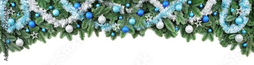 Leinwanddruck Bild Rand aus Tannenzweigen, dekoriert mit kühlen Farben