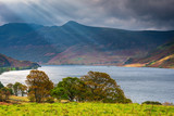 Sunbeams at Crummock Water / Crummock Water is a lake in the English Lake District which is now a Unesco World Heritage Site. - 229548741