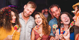 Young people dancing and drinking champagne at confetti party night - 229549977