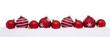 Red christmas big and small balls isolated on snow, Christmas decoration