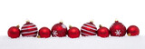 Red christmas big and small balls isolated on snow, Christmas decoration