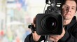 Leinwanddruck Bild - Cameraman working with camera  on background