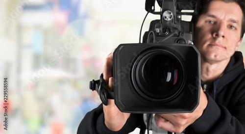 Leinwanddruck Bild Cameraman working with camera  on background