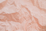 Colorful peachy crumpled paper texture.