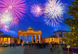 Bradenburg Gate with Christmas tree at night with fireworks, Berlin Germany