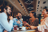 Group of Happy friends having with smartphone in cafe - 229575534